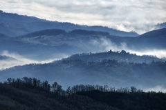 Foggy hills. Morning fog in low hills of Medvednica mountain, near Zagreb, Croatia Royalty Free Stock Images