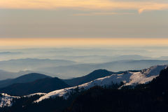 Foggy hilltops. Fog covered hilltops in a winter scenery Stock Photos