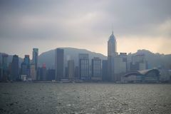 Foggy Hong Kong on Victoria`s harbour from Tsim Sha Tsui waterfront stock images