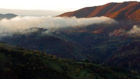 foggy and hot sunrise in Carpathian mountains stock footage