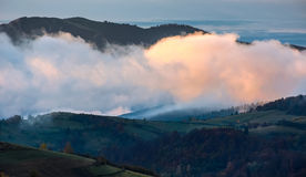 Foggy and hot sunrise in Carpathian mountains Stock Images