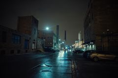Foggy industrial urban street city night scenery. Foggy industrial urban street city night scenery in Chicago with vintage warehouses, factories and smokestacks Royalty Free Stock Photography