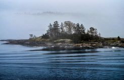 Foggy island Royalty Free Stock Photos