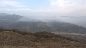 A foggy january day in the mountains of Azerbaijan. A foggy january day in the mountains, Azerbaijan stock video footage