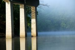 Foggy lake bridge Stock Image