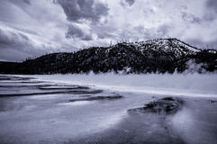 Foggy lake. Fog on lake in front of mountain Stock Images