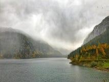 Foggy lake Gosau at Dachstein mountain in Salzkammergut, Austria Royalty Free Stock Images