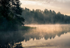 Foggy lake at morning. Scenic landscape with lake and sunrise at autumn morning in Finland. Hämeenlinna, Finland Stock Photos