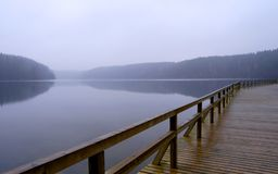 Foggy lake and pier royalty free stock photos