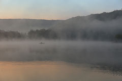 Foggy lake at sunrise Stock Photography