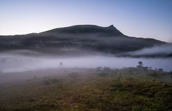 Foggy view from Lofoten Norway at bright summer night. Royalty Free Stock Photography