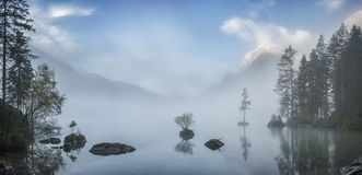 Foggy Landscape with Lake Stock Photo