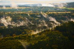 Foggy landscape. Misty foggy morning with sunrise in a valley of Bohemian Switzerland park. Detail of forest, landscape of Czech. Republic, beautiful national royalty free stock photo