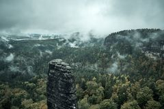Foggy landscape. Misty foggy morning with sunrise in a valley of Bohemian Switzerland park. Detail of forest, landscape of Czech. Republic, beautiful national stock images