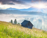 Foggy landscape with an old barn Royalty Free Stock Photography
