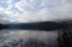 Foggy landscape with water reflection Stock Image