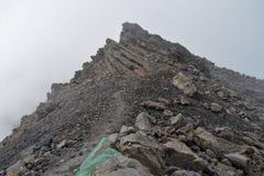 Foggy landscapes at Mount Meru. Rock formations against a foggy background at Mount Meru, Arusha National Park, Tanzania  hike trek trekking landscape travel stock photo