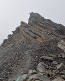Foggy landscapes at Mount Meru. Rock formations against a foggy background at Mount Meru, Arusha National Park, Tanzania  hike trek trekking landscape travel stock photos