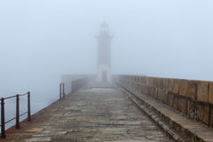Foggy lighthouse royalty free stock photos