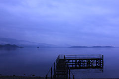 Foggy at Loch Lomond. A bridge for seaplane at Lake district,UK Stock Photography