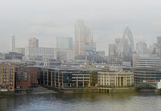 Foggy London. Foggy cityscape of London from Thames river Stock Photos