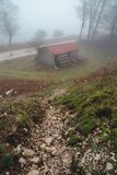 Foggy Matese Mountain Range Cabin. On a spring afternoon in Italy royalty free stock photo