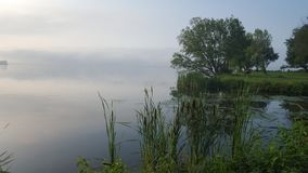 Foggy/Misty Lake in the Morning stock photography