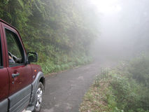 Foggy misty mountain road in India Stock Images