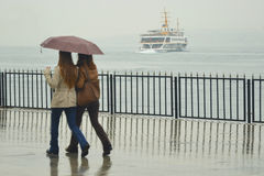Foggy misty rainy Istanbul. Istanbul, Turkey - April 18, 2014: Foggy misty rainy Istanbul, People are trying to reach the ferry pier in Kadikoy royalty free stock photos