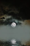 Foggy Moon. Rising moon on a foggy night over the ocean royalty free stock photos