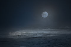 Foggy moon over the sea Royalty Free Stock Photo