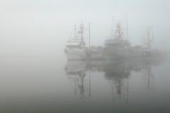 Foggy Moorage, Steveston Harbor. Dense fog surrounds seine boats moored in Steveston Harbor near Vancouver. British Columbia, Canada Royalty Free Stock Photo