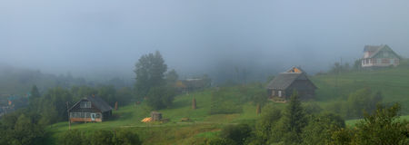 Foggy morning. In carpatian village Royalty Free Stock Images