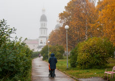 Foggy morning in Arkhangelsk. Walking in the rain. The road leading to the temple Royalty Free Stock Images