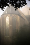 Foggy morning around the church Stock Photography