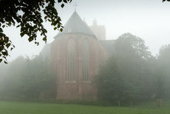 Foggy morning around the church Stock Image