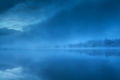 Foggy morning on Barmsee lake Stock Photography
