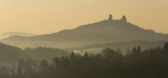 Foggy morning with castle ruins stock images