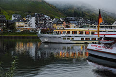 Foggy morning in Cochem city. Ferry on Mosel river Royalty Free Stock Photography