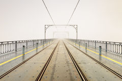 Foggy morning at Dom Luis Bridge in Oporto city Stock Images