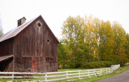 Foggy morning. Early morning drive in the fog and I came across this wonderful barn out in the country. I love fall time Stock Photos