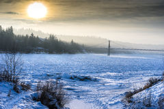 Foggy morning at Fort Edmonton Park footbridge in January Stock Image