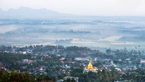 Foggy morning at Hpa An city with Gabar Lone Pagoda. Myanmar (Bu Stock Images