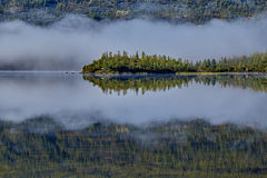 Foggy morning on island. Jack Londonas lake. Kolyma Stock Photography
