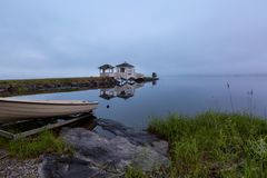 Foggy morning on the lake and boat on foreground stock photo