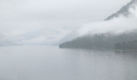 Foggy morning on  lake Stock Photos