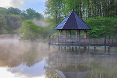 Foggy Morning on Lake. Fog over Lake Caroline and gazebo at Meadowlark, a Northern Virginia regional park, Vienna VA Stock Photos
