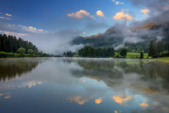 Foggy Morning on lake landscape, with beautiful clouds and refle Stock Photography