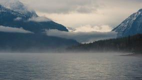 Foggy morning at Lake McDonald. Stock Photo