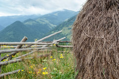 Foggy morning landscape with hay stack on meadow Royalty Free Stock Photos